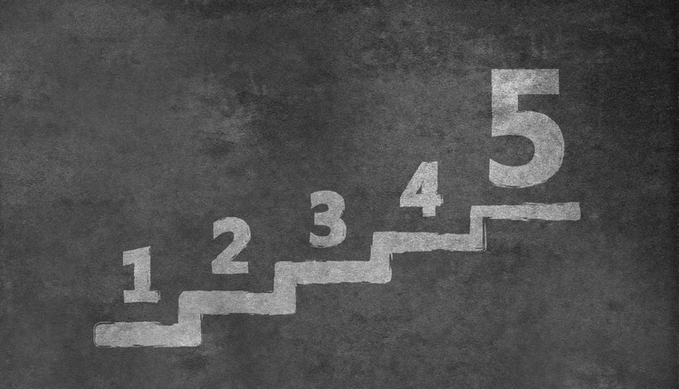 Stair with number one to five on a blackboard